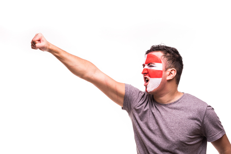 Fan support of Croatia national team with painted face shout and scream isolated on white