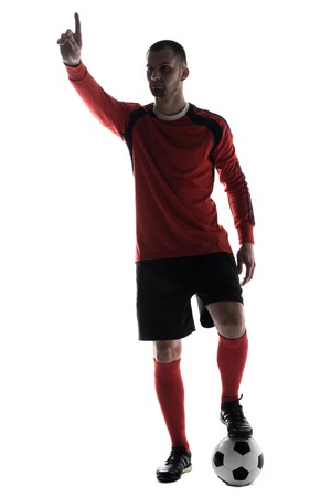 Silhouette of young football player pointed with finger with soccer ball isolated on white