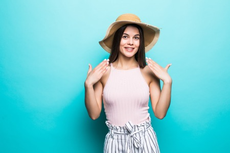 Image of shocked excited young lady standing isolated over blue background. Looking camera.