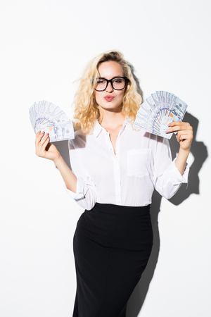 Businesswoman holding money with smile isolated on white background. Banco de Imagens - 110025152