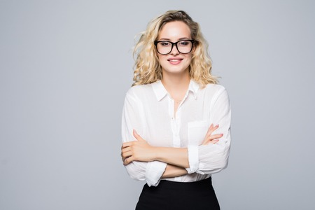 Portrait of attractive blond businesswoman with arms crossed isolated on white background