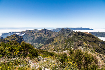clouds and peaks at the top of the highest mountain of Madeira - Pico Ruivo, Portugal Stock Photo