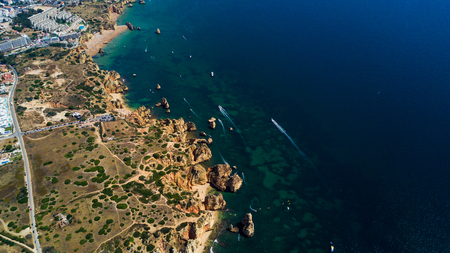 Aerial view of cliffs and beach near Lagos city in Algarve coast at Portugal Banco de Imagens