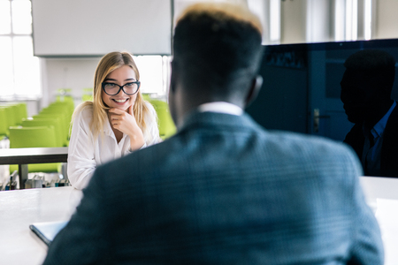 Two people working in a modern office Stock Photo