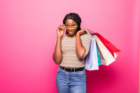 Portrait of African American woman carrying shopping bags