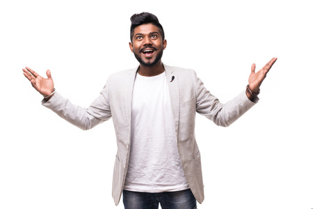 Portrait of hipster indian bearded man raised hands isolated on white background 版權商用圖片