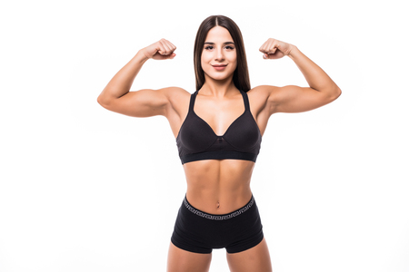 Portrait of a beautiful fitness woman showing her biceps isolated on a white background