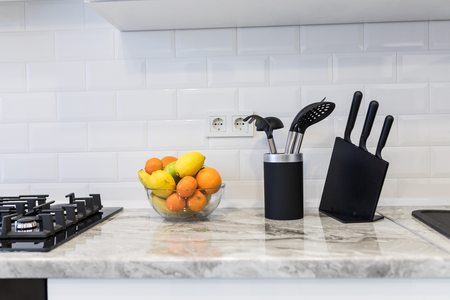 Modern interior decoration of bright kitchen with sink accesories and fruits Stock Photo