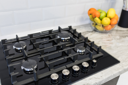 Modern stylish kitchen gas stove. Kitchen accesories.