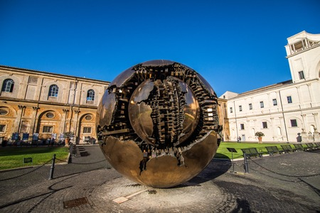 VATICAN, ITALY - November, 2018: Sphere and a bronze sculpture in the courtyard of Vatican Museum