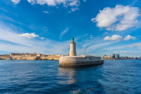 Green Lighthouse in the Grand Harbour in Valletta city - capital of Malta. Malta island. Mediterranean sea 版權商用圖片