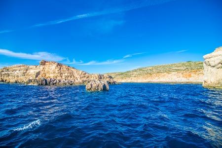 Cliffs and sea view of Comino island, Malta. Seascape at Malta, Comino and Gozo islands Фото со стока