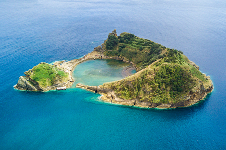 Top view of Islet of Vila Franca do Campo is formed by the crater of an underwater volcano near San Miguel island, Azores archipelago, Portugal.