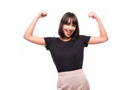 Strong woman. Beautiful young woman showing her muscularity and looking at camera while isolated on white Stock Photo