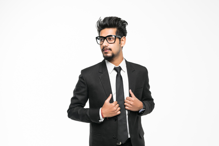 Closeup portrait of handsome young indian businessman isolated on white background. Positive human emotions facial expressions, feelings, attitude perception