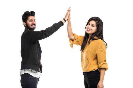 Young indian couple take selfie on green background
