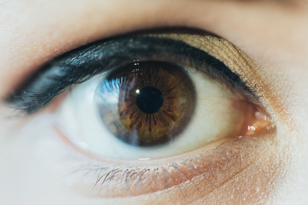 Close up picture of brown eyes from a young man