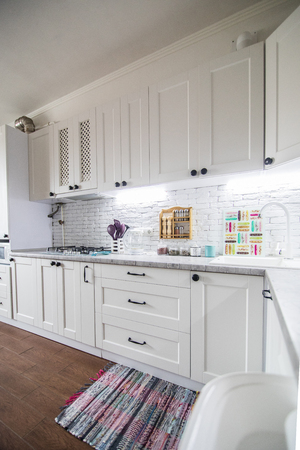 Modern white kitchen, gas stove with electric oven, clean design