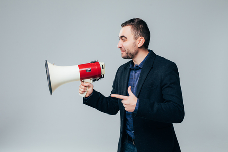 Businessman shouting by megaphone isolated on white background