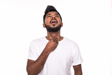 Portrait of Indian man sore throat, hand on neck clearing throat on white background 스톡 콘텐츠
