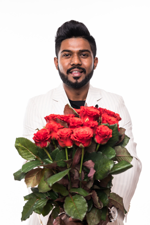 Happy businessman holding roses flowers bouquet over white background.