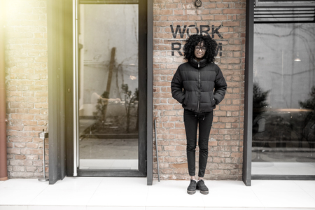 Portrait of a young black woman, model of fashion in urban background Stock Photo