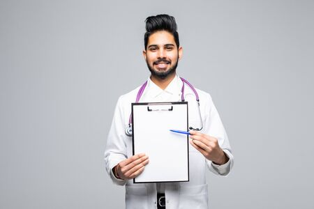Closeup portrait of handsome male health care professional or doctor or nurse holding clipboard up and showing space for text, isolated on white background with copy space Imagens