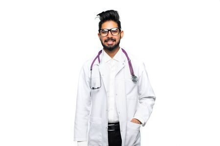 Male Indian doctor wearing a white coat and stethoscope. Isolated on white background. 스톡 콘텐츠