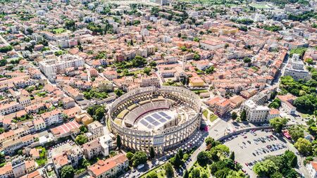 Pula aerial drone shot. The Arena is the only remaining Roman amphitheatre to have four side towers and with all three Roman architectural orders entirely preserved. It was constructed in 27 BC 68 AD