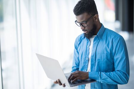 african american businessman working on laptop in modern office Stock fotó