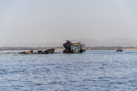 Shipwreck near the island of Tiran - attraction of the resort of Sharm - El - Sheikh. Egypt, Red Sea. Stok Fotoğraf