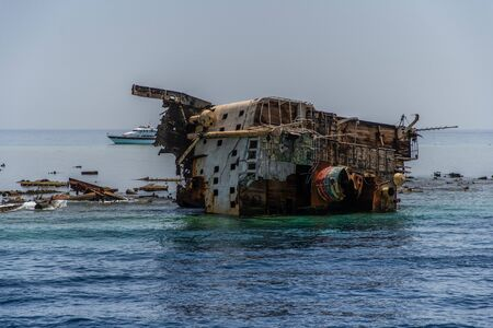 Shipwreck near the island of Tiran - attraction of the resort of Sharm - El - Sheikh. Egypt, Red Sea. 版權商用圖片 - 131144814