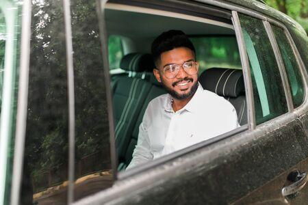 Serious businessman using his phone in his car Stock fotó