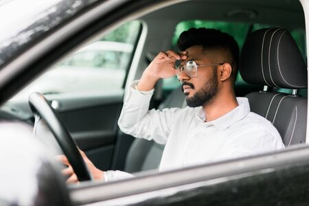 Tired man sleeps while driving