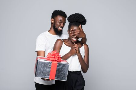 Man offering gift to woman on her birthday Stock Photo