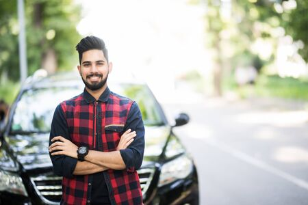 Young man poses with his car. Stok Fotoğraf - 130497373