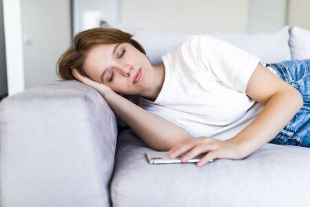 Beautiful woman sleeping on sofa in lounge Stock fotó