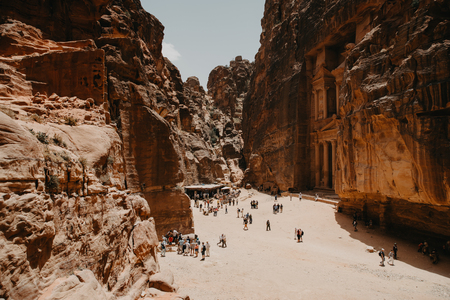 JORDAN, Ancient Petra - May, 2019:Tourist complex of the ancient city of Petra with tourists