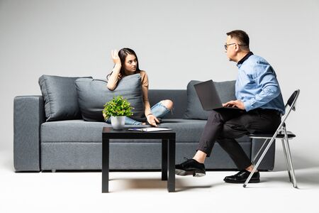 Young woman during therapy at psychologist's office