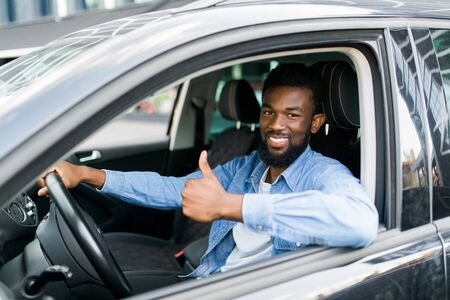 happy african businessman giving thumb up inside new car Stock fotó