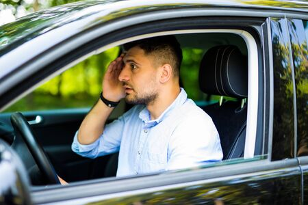 Stressed young driver man in his car