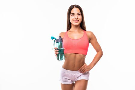 sporty muscular woman drinking water, isolated against white background Standard-Bild - 134467342