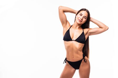 Pretty tanned woman in bikini isolated on white background Standard-Bild - 134457652