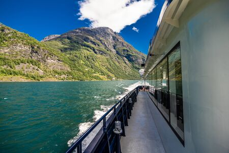 Geiranger, Norway - June, 2019: Hurtigruten cruise liner sailing on the Geirangerfjord, one of the most popular destination in Norway and UNESCO World Heritage Site. Stock fotó