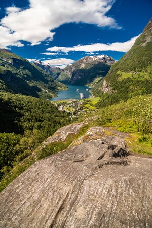 Picturesque summer scene of Geiranger port, western Norway. Colorful view of Sunnylvsfjorden fjord. Traveling concept background. Artistic style post processed photo.