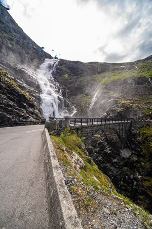 Trollstigen, Norway - June, 2019: Famous norwegian mountains road Trollstigen top view of valley. Epic nordic nature with rocks, waterfalls, dramatic clouds Sightseeing tourism, travel europe Stock fotó