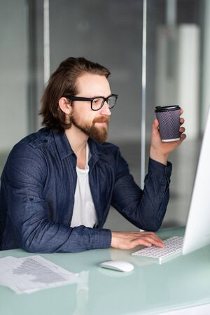 Businessman at work with laptop in his office