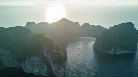 Top view of isolated rocky l island with turquoise water and white beach. Aerial view of Phi-Phi Leh island with Maya Bay and Pileh Lagoon. Krabi province, Thailand.