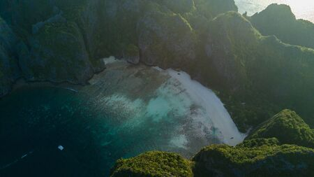 Top view of isolated rocky l island with turquoise water and white beach. Aerial view of Phi-Phi Leh island with Maya Bay and Pileh Lagoon. Krabi province, Thailand. Reklamní fotografie