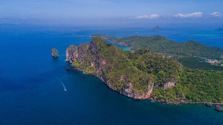 Aerial drone photo of Tonsai pier and iconic tropical beach and resorts of Phi Phi island, Thailand